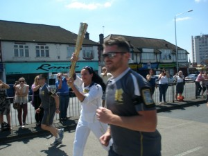 Melba running with the torch